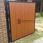 SS32 - Vertical wood look aluminium slats single gate