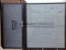 SS39 – Black Post + Frame with Woodland Grey Aluminium Slats Single Gate with Panel – Laverton