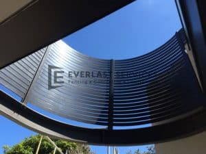 A16 - Curved Metropolis Bronze Slats Upward View