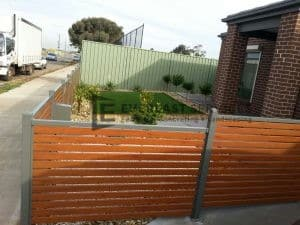 A59 - Brown Slat Fence with landscaping