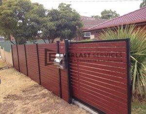 A33 - Black Post + Horizontal Jarrah Slats Fencing and Sliding Gate