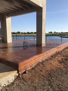 T76 - Merbau Decking with Lake Back Drop