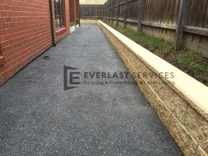 EA1 - Dark Exposed Aggregate Side of House