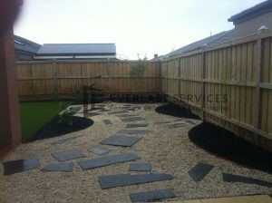 L11 - Landscaping with gravel, pavers and grass