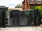 DW33 – Steel Vertical Slats Sliding Gate