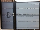 SS39 – Black Post + Frame with Woodland Grey Aluminium Slats Single Gate with Panel – Laverton