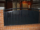 SF46 – Black Vertical Slats with Feature Ring Steel Fencing Infills