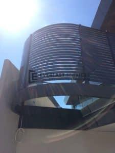 A13 - Curved Metropolis Bronze Slats Side Upward View