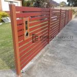 A164 - Manor Red Aluminium Slats Fencing with 90mm Jarrah Slats