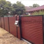 A33 - Black Post + Horizontal Jarrah Slats Fencing and Sliding Gate