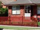 SF125 – Manor Red Steel Picket Fencing
