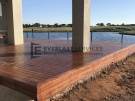 T76 – Merbau Decking with Lake Back Drop