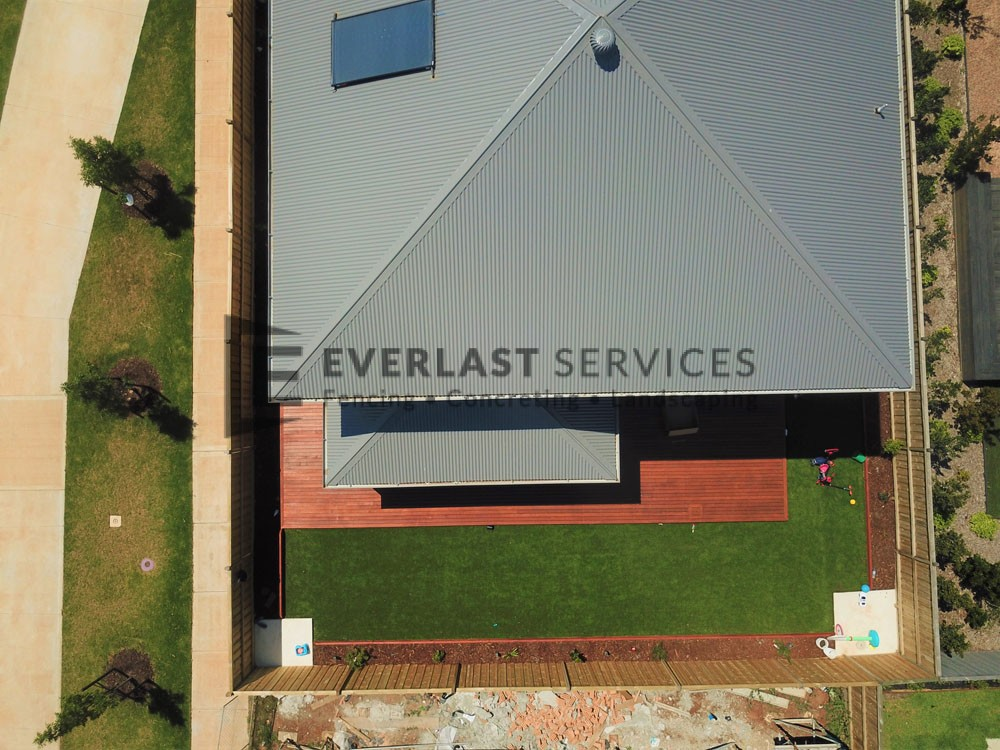Top Down View of Back Yard Decking with Synthetic Grass