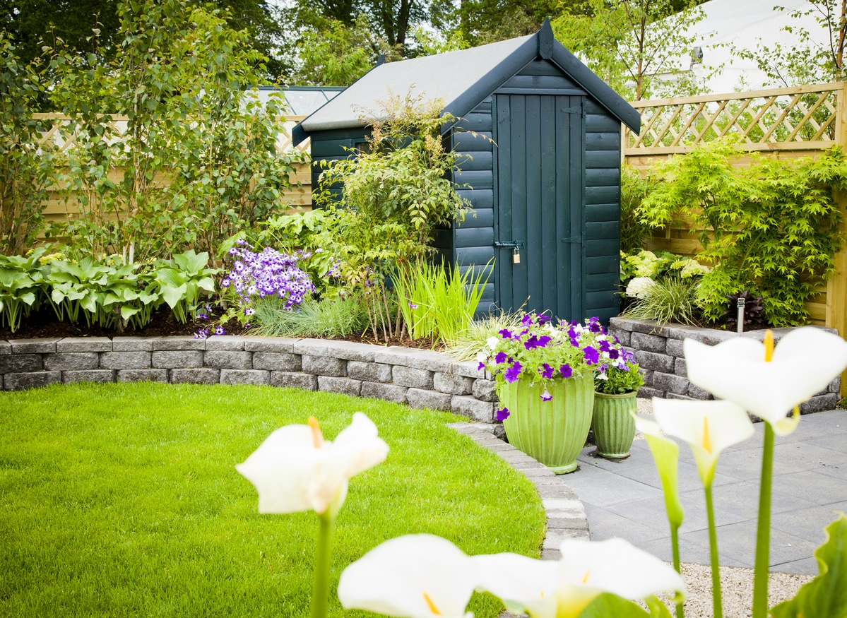 Garden shed in a beautiful green garden