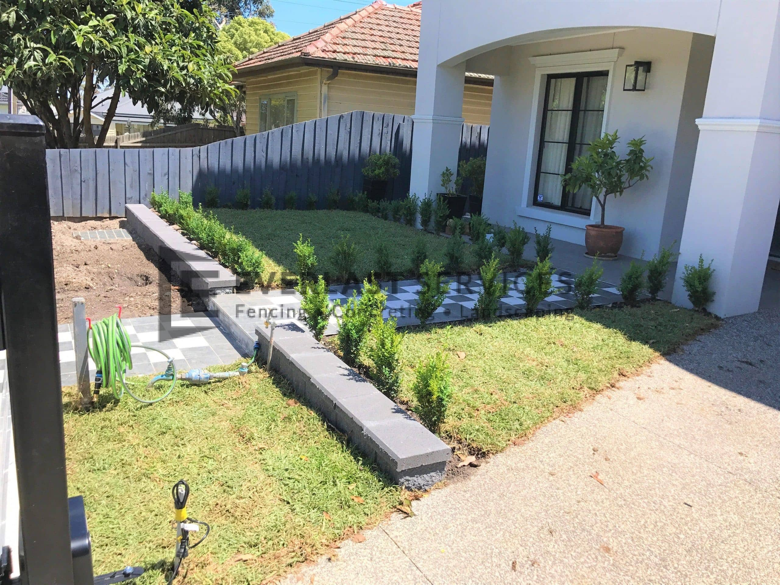 L196 - Front Landscaping with Tiling and Retaining Wall