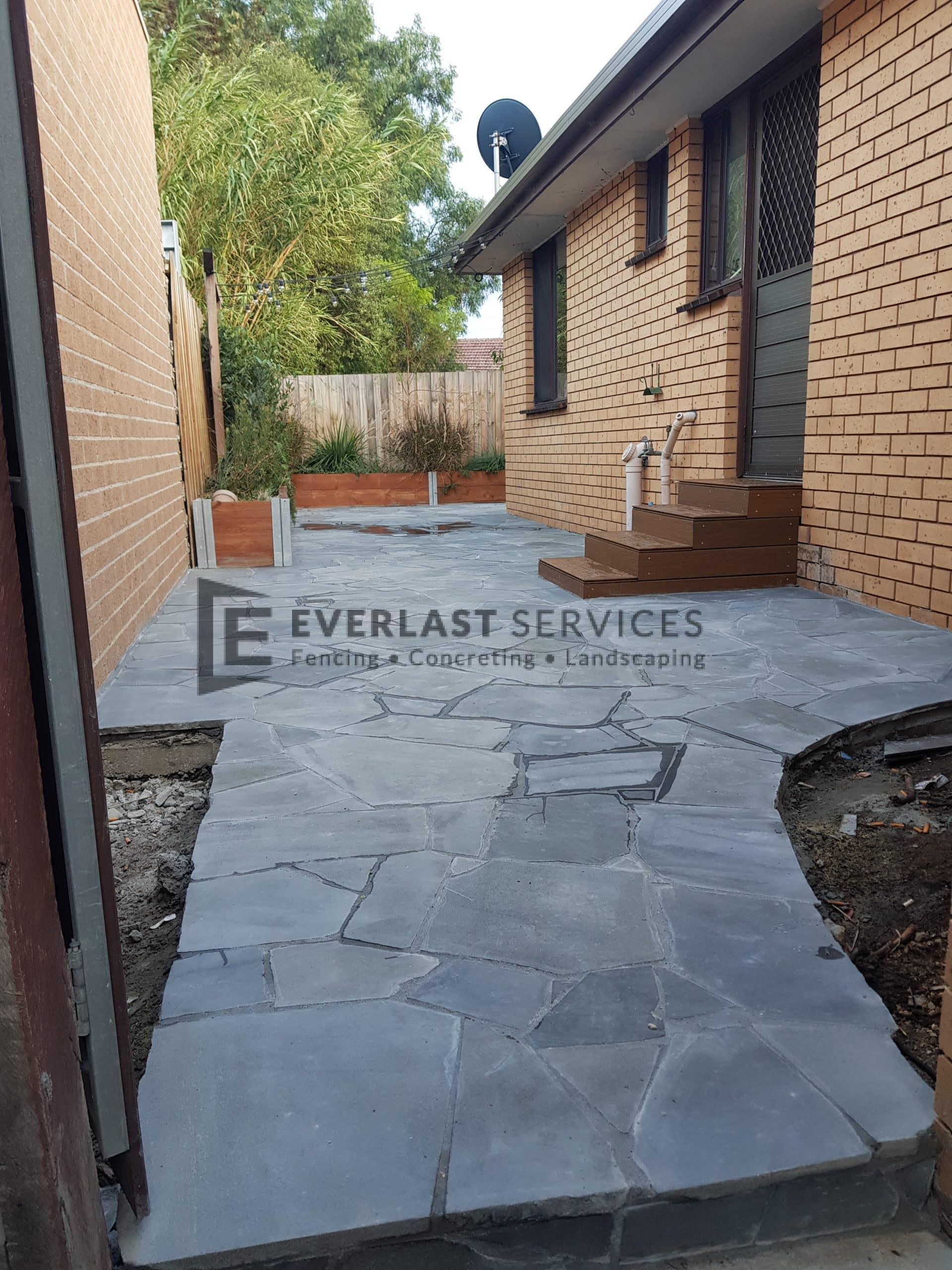 L278 - Everlast Landscaping stenciled concrete back door