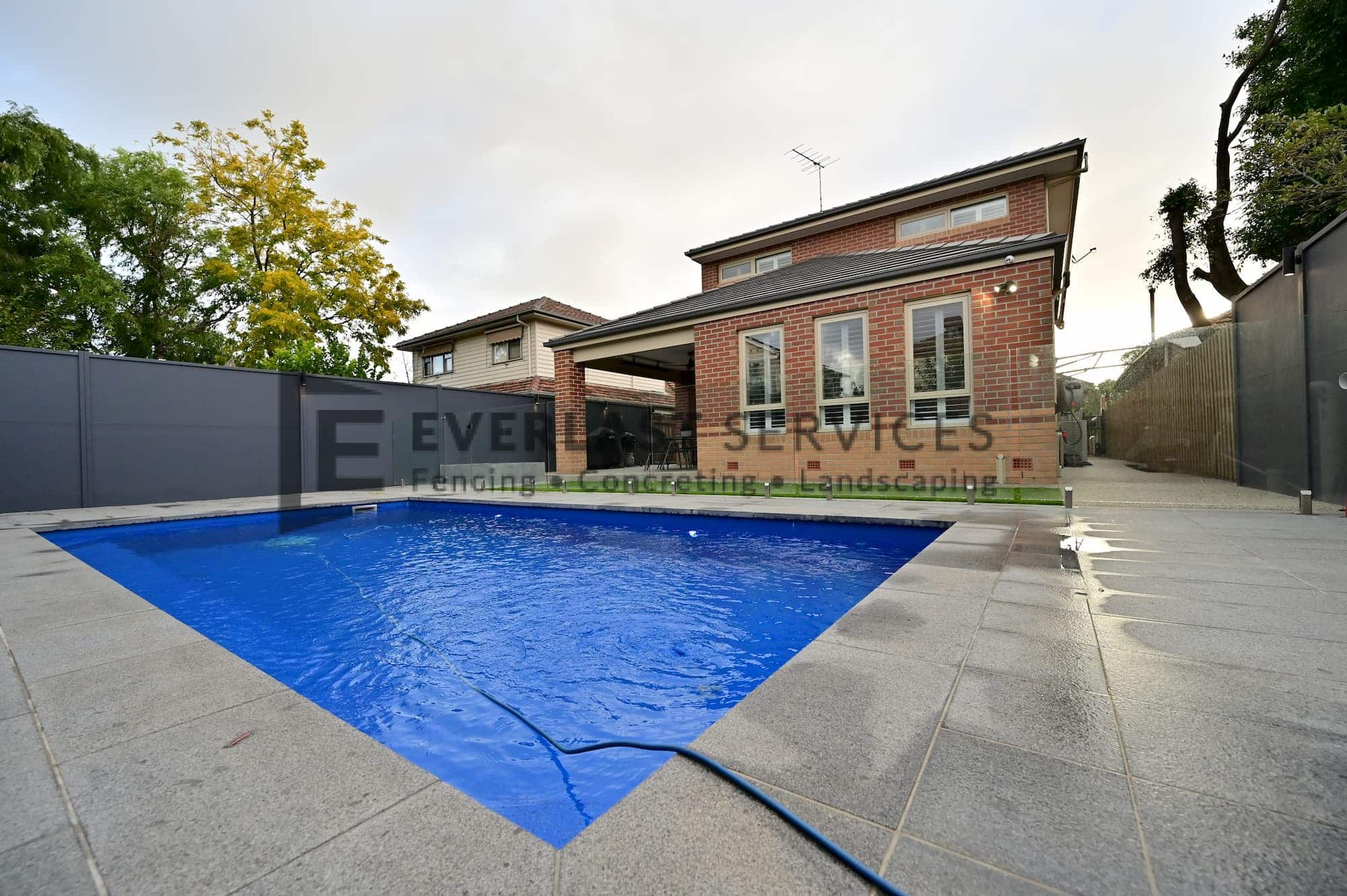 L285 - Yarraville - Backyard Landscaping with Glass Pool Fence (Corner Perspective)