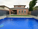 L284 – Yarraville – Backyard Landscaping with Glass Pool Fence looking directly at the house