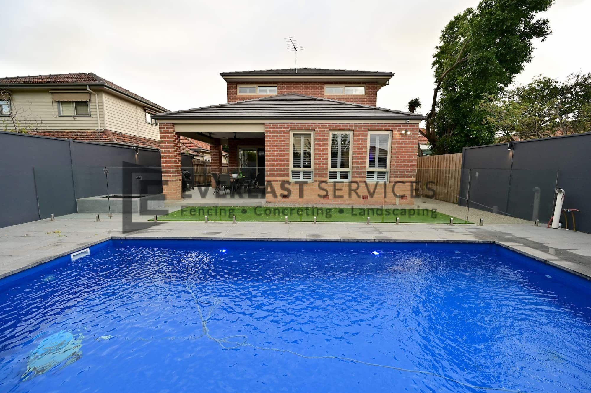 L284 - Yarraville - Backyard Landscaping with Glass Pool Fence looking directly at the house